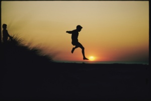 boy leaping at dawn